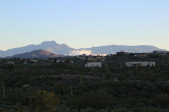 Sonoran desert. By the Superstition Mountains at sun rise with four-peaks in the background Stock Image