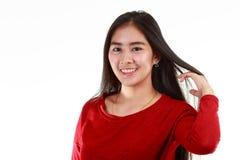 Sonrisa adolescente asiática en el fondo blanco Foto de archivo libre de regalías