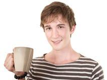 Sonrisa adolescente con la taza Fotografía de archivo