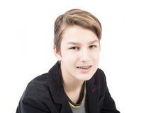 Sonrisa adolescente con los apoyos ortodónticos Imagen de archivo libre de regalías