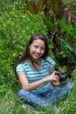 Sonrisa adolescente de las imágenes que toma Imagenes de archivo