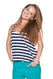 Sonrisa adolescente positiva de la muchacha Foto de archivo libre de regalías