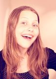 Sonrisa adolescente preciosa de la muchacha Foto de archivo