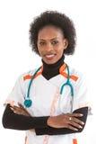Sonrisa afroamericana femenina del doctor o de la enfermera aislada sobre el fondo blanco fotos de archivo