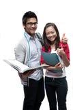 Sonrisa asiática de dos estudiantes Imágenes de archivo libres de regalías
