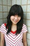 Sonrisa asiática de la muchacha Fotografía de archivo libre de regalías