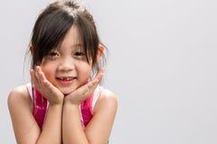 Sonrisa asiática de la muchacha Imagen de archivo libre de regalías