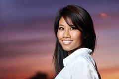 Sonrisa asiática de la mujer Fotografía de archivo libre de regalías