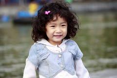 Sonrisa asiática de los niños Fotografía de archivo libre de regalías