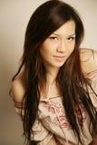 Sonrisa asiática hermosa de la muchacha Fotos de archivo libres de regalías