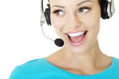Sonrisa auxiliar del llamar-centro joven hermoso Foto de archivo libre de regalías