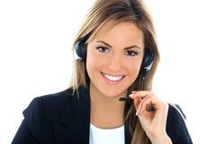 Sonrisa auxiliar rubia del operador Foto de archivo libre de regalías