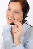 Sonrisa cómoda de la mujer del puesto de informaciones Imagen de archivo libre de regalías