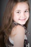 Sonrisa cabelluda linda del niño de Brown Fotografía de archivo