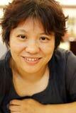 Sonrisa china de la mujer Foto de archivo libre de regalías