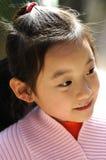 sonrisa china de los niños imagen de archivo
