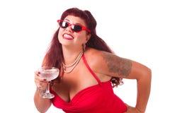 Sonrisa con una bebida Foto de archivo libre de regalías