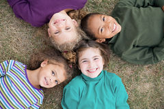 Sonrisa de cuatro muchachas Imagenes de archivo
