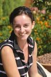 Sonrisa de la chica joven Foto de archivo libre de regalías