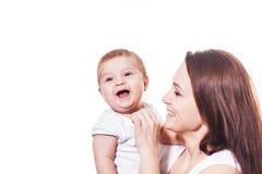 Sonrisa de la madre y del bebé Fotos de archivo