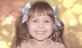 Sonrisa de la niña Fotos de archivo