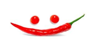 Sonrisa de la pimienta y tomates de los ojos Imagen de archivo libre de regalías