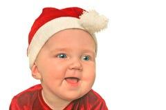 Sonrisa del bebé de la Navidad Foto de archivo
