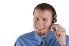 Sonrisa del empleado del centro de atención telefónica Imágenes de archivo libres de regalías