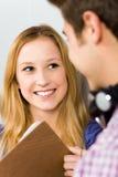 Sonrisa del estudiante femenino Imagenes de archivo