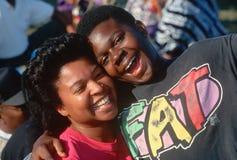 Sonrisa del hermano y de la hermana del afroamericano Imagenes de archivo