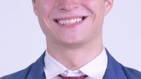 Sonrisa del hombre de negocios joven feliz almacen de video