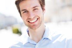 Sonrisa del hombre joven Fotografía de archivo libre de regalías