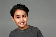 Sonrisa del muchacho de la raza mixta Imagenes de archivo