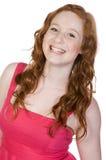 Sonrisa dirigida bastante roja del adolescente Imagenes de archivo