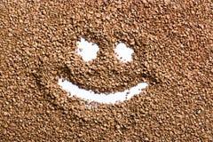 Sonrisa divertida de los gránulos del café Imagen de archivo libre de regalías
