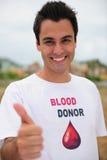 Sonrisa donar de la sangre feliz Foto de archivo libre de regalías