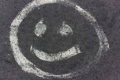 Sonrisa en el pavimento Foto de archivo libre de regalías