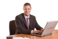 Sonrisa en oficina Imagen de archivo libre de regalías
