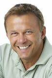 Sonrisa envejecida media del hombre Imagen de archivo libre de regalías