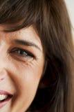 Sonrisa espontánea de la mujer Imagen de archivo libre de regalías