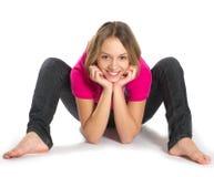 Sonrisa estirando a la muchacha Fotografía de archivo