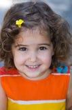 Sonrisa feliz de la niña Fotos de archivo