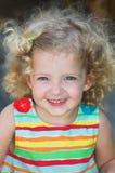 Sonrisa feliz de la niña Imagen de archivo