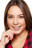 Sonrisa femenina adolescente con los apoyos en sus dientes Fotos de archivo libres de regalías