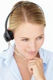 Sonrisa femenina del operador del centro de atención telefónica Fotografía de archivo
