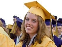 Sonrisa graduada en casquillo y vestido Imagenes de archivo