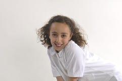 Sonrisa hermosa de la chica joven Foto de archivo libre de regalías