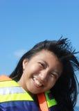 Sonrisa hermosa de la muchacha Fotografía de archivo libre de regalías