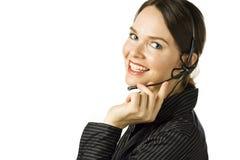 Sonrisa hermosa del agente del servicio de atención al cliente. Fotografía de archivo libre de regalías