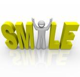 Sonrisa - hombre sonriente en palabra Foto de archivo libre de regalías